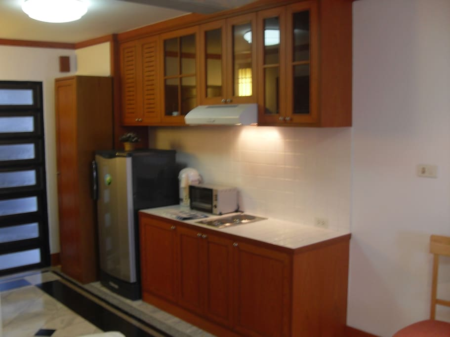 Spacious Kitchen area to cook your own meals or warm up the ready-made food available in nearby Supermarkets.