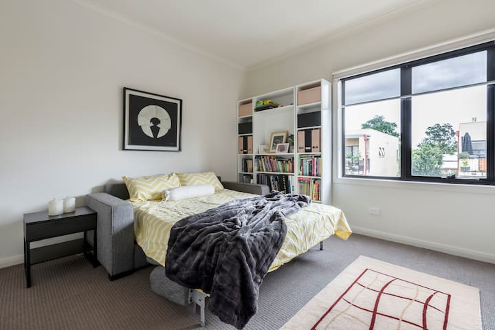 The second bedroom offers a comfortable double sofa bed, permanently set up for guests.