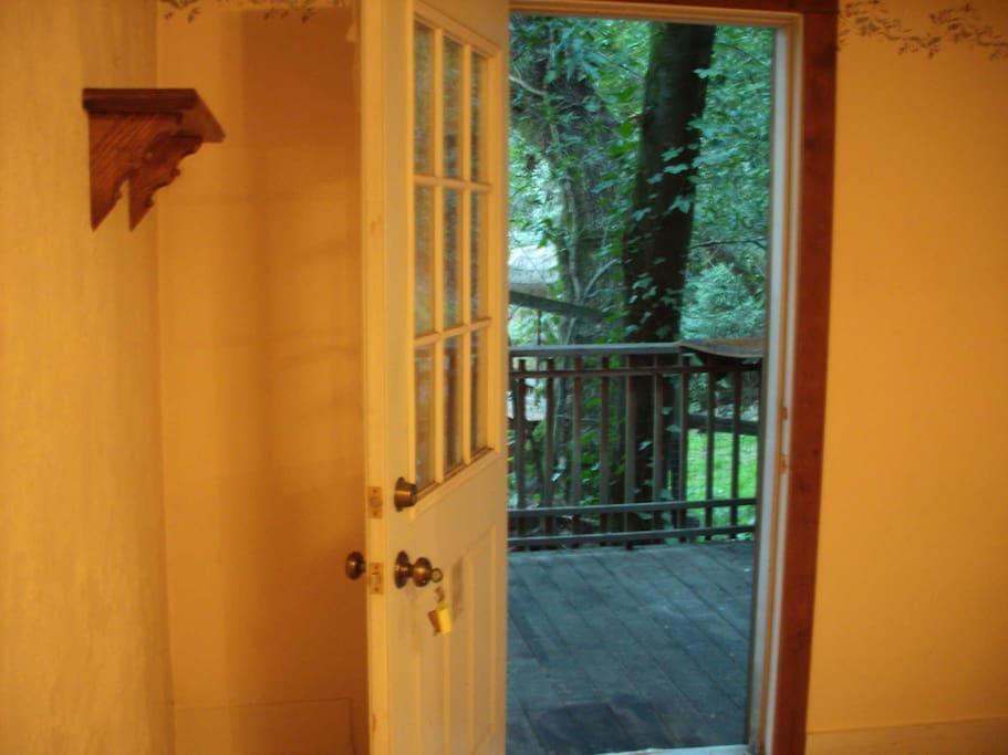 door to living room with private deck...have some coffee on the deck and watch the deer go by!