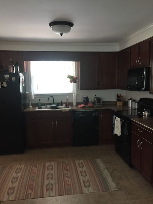 Kitchen with all appliances including coffee maker, dishes, and anything you would need to cook.