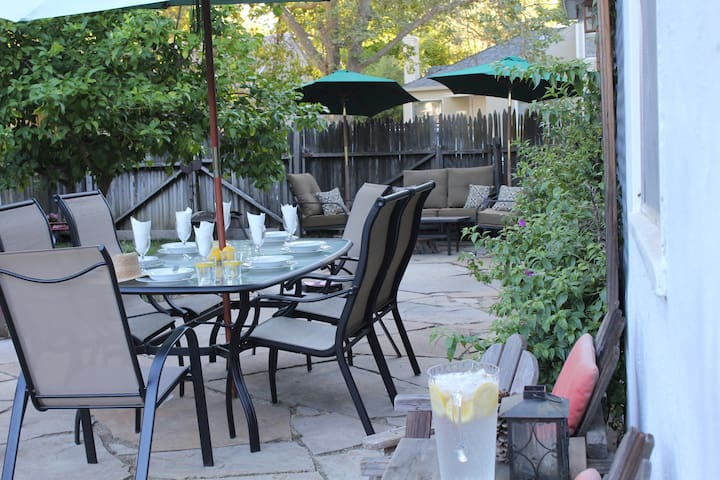 The Cottage   View of the back yard w/ dining table. The window on the wall to the right is yours!