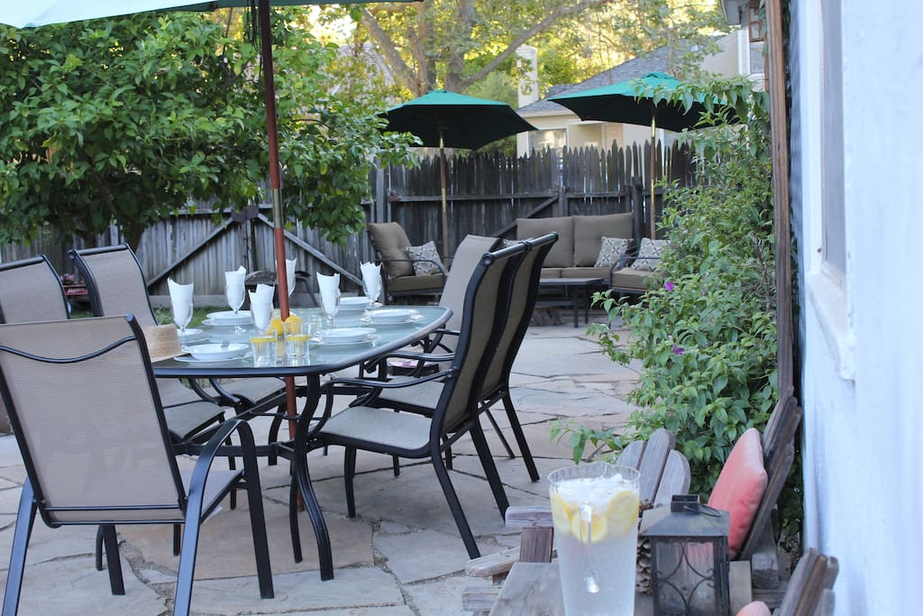 The Cottage | View of the back yard w/ dining table. The window on the wall to the right is yours!