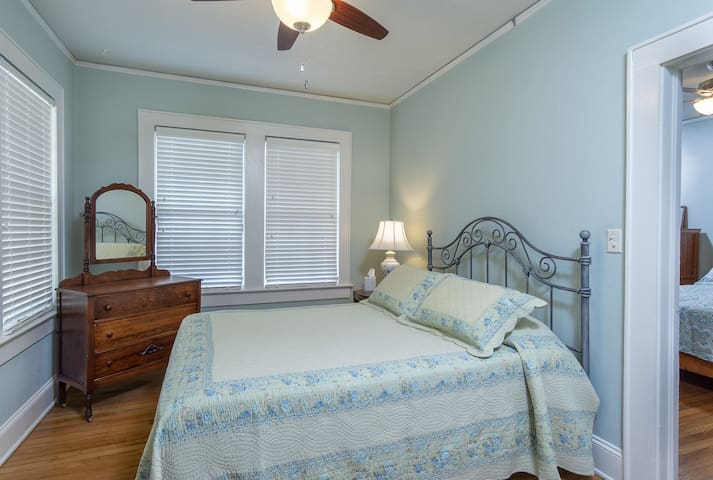 A queen bed. This bedroom is accessed through the first bedroom.