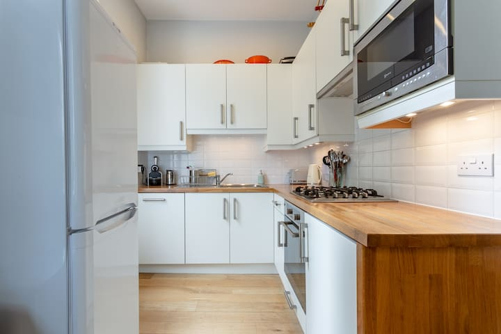 Kitchen with dishwasher, gas hob, electric oven and built in mircrowave.