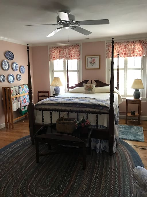 Guest Room 1 with queen bed with working stove fireplace.