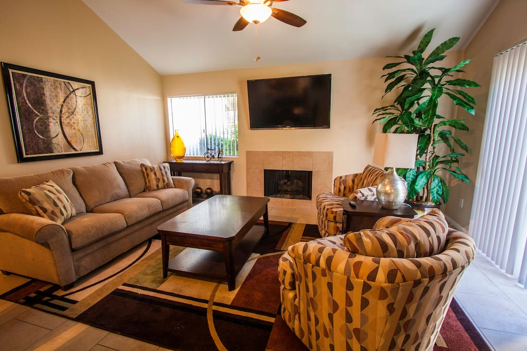 Living Room is well designed, relaxing... BBQ right outside sliding door! Flat Screen TV, too!