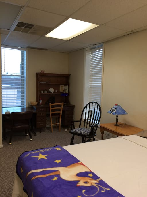 Living/study area; flat screen cable TV can be viewed from either rocking chair or bed.