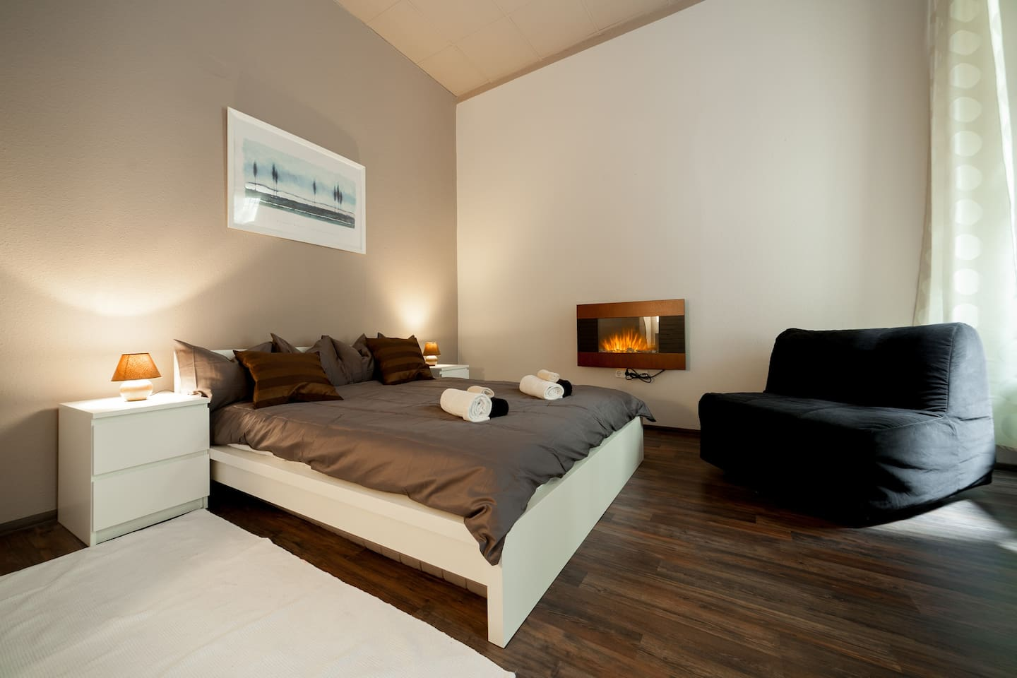Enjoy the cozy and quiet bedroom with the romantic electric chimney