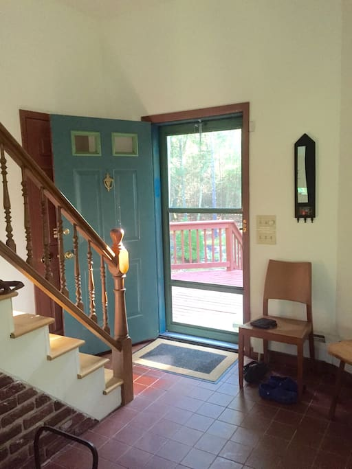 Front door and stairs leading to your bedroom, bathroom and upstairs living area