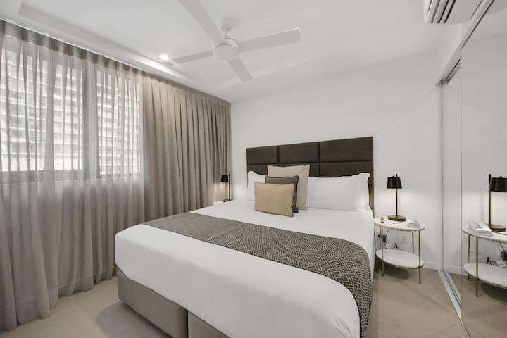 The large bedroom with ultra comfortable king bed, air-conditioning, large wardrobe plus a wall-mounted 4K TV with Netflix capabilities!