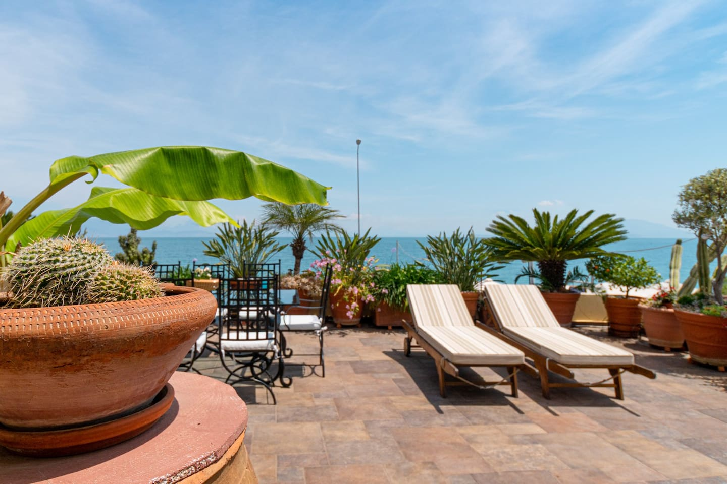 Big private Terrace with sunbeds, dining tables,swing,BBQ and unlimited seaview