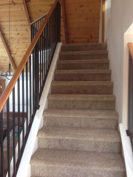 Front entry stairs to loft and master bedroom.