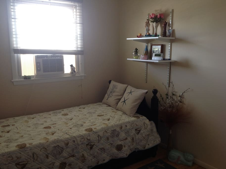 Private bedroom featuring comfortable bed w/pull out twin bed underneath.  Sleeps 2.  AC