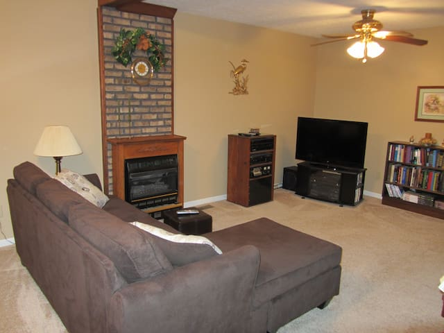 Flat screen with DVD player in living area.