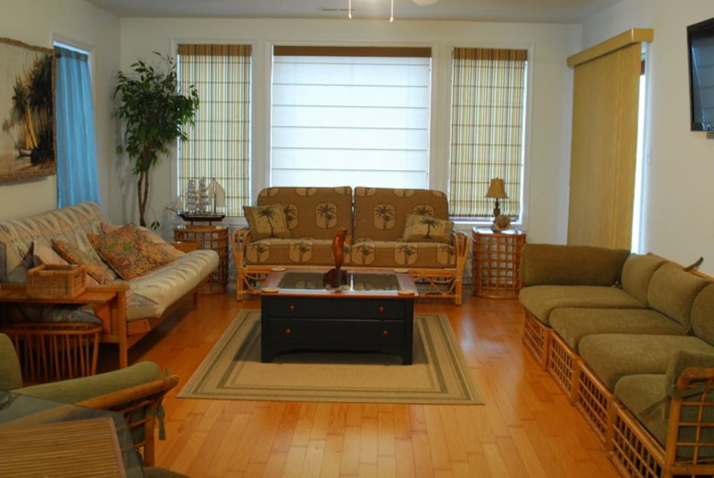 Beautiful, spacious, sunny living room with plenty of seating for the whole family!