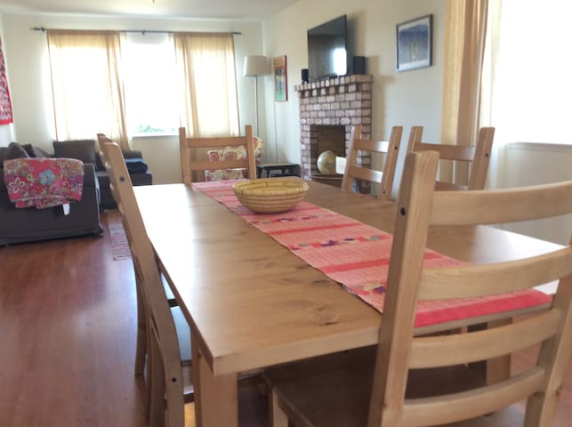 Long dining room table seats six.