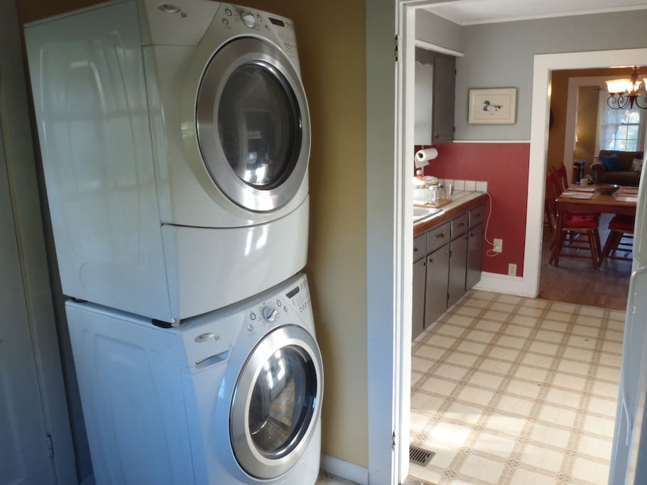 Stacked washer and dryer in mud-room