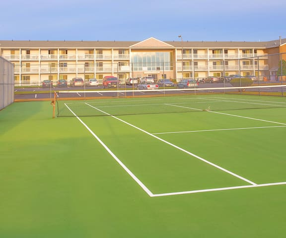 Private tennis court available for all guests.