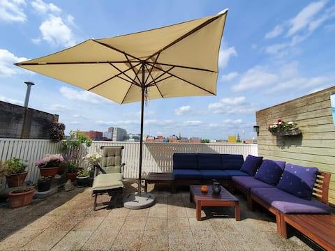 Sala de estar privada y terraza en la azotea.