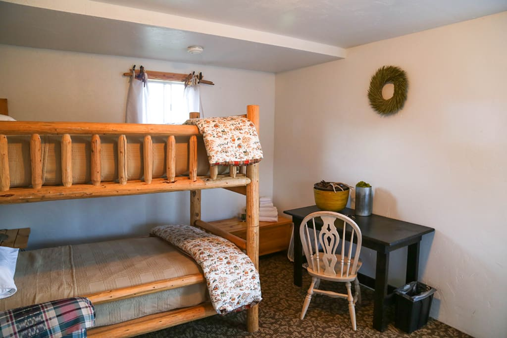A handmade log bunk bed