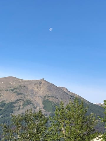 A morning moon over Whistler Mountain and the tramway.