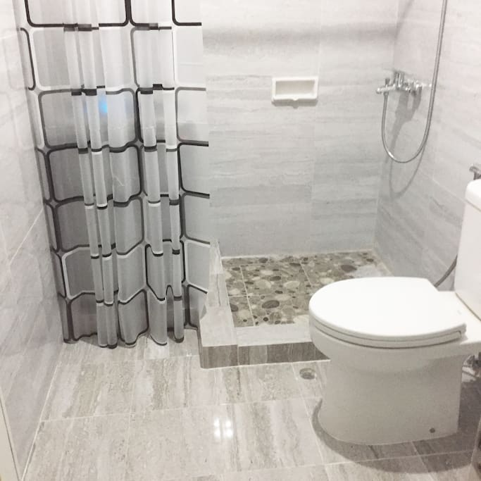Newly renovated bathroom with hot shower and washing machine
