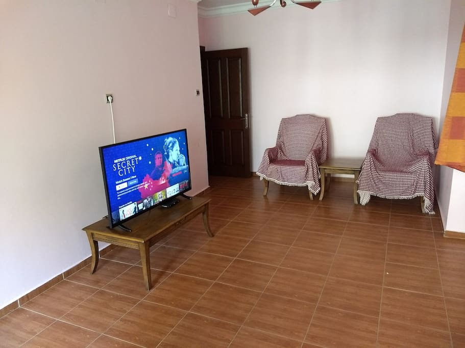 2nd bedroom with LCD TV and seaters