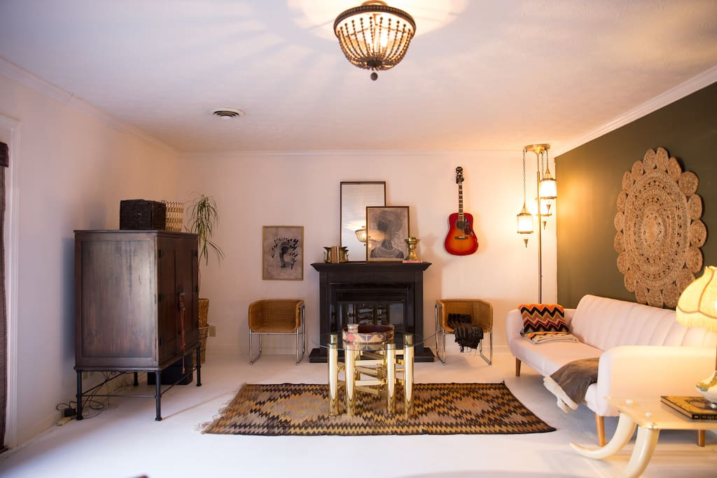 Spacious & stylish living area- electric fireplace works! Feel free to play the guitar! Tv with Netflix & basic cable as well as a selection of dvds for your enjoyment!