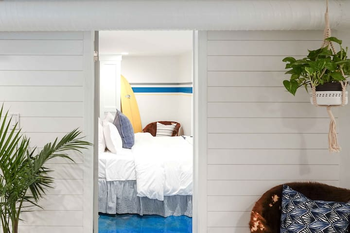 With shiplap accent walls and coastal charm, this quiet suite offers a unique getaway!