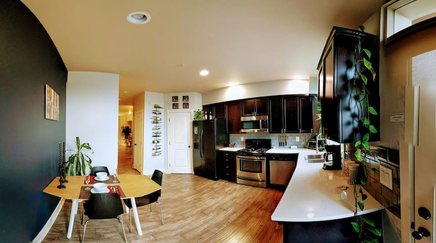Spacious, fully stocked kitchen.  Feel free to cook up a meal.