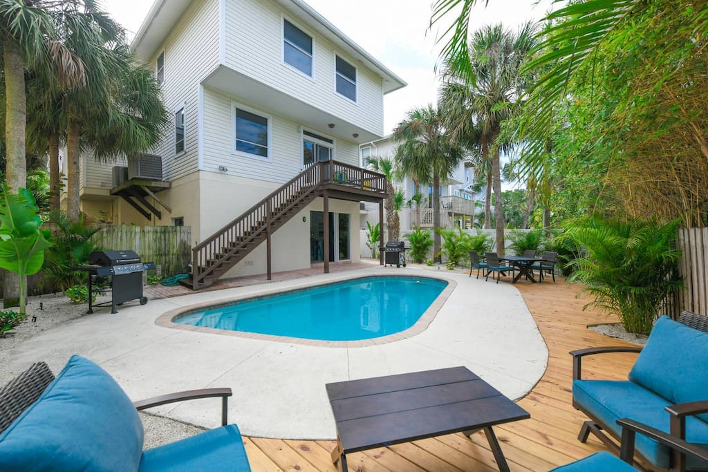 Shared Pool with Outdoor Seating and BBQ Grill