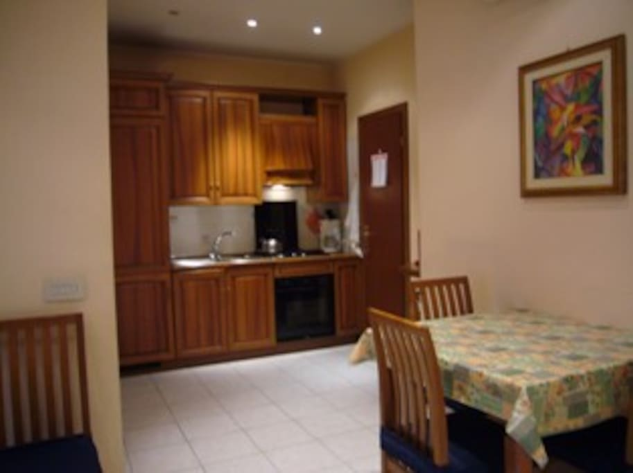 Fully equipped kitchen with dining area, where you can cook your meals and have breakfast before the day starts.