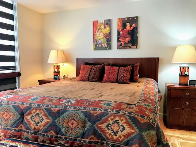 Upstairs bedroom with queen bed and built in closets