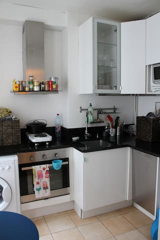 Full-size kitchen with stove, oven, dishwasher, microwave and full-size fridge.