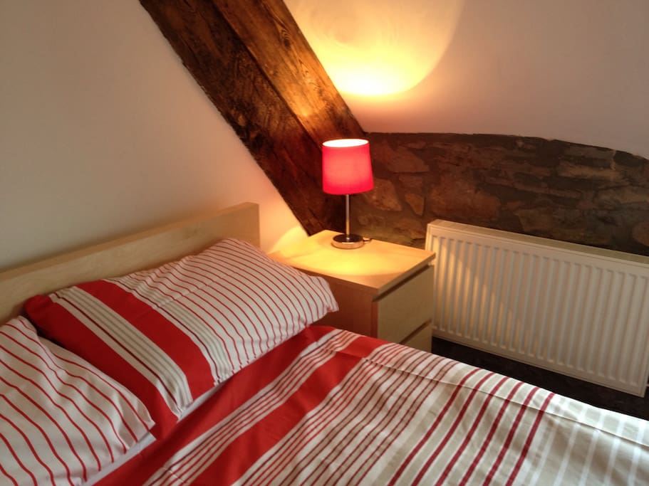 Double bedroom upstairs. Old wooden beams .