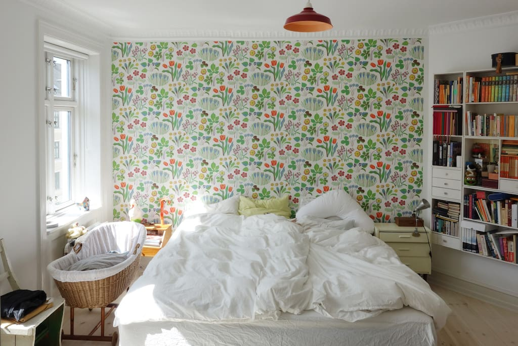 Master bedroom - with Josef Frank wallpaper and crib for baby (the crib is now a bed for a toddler)