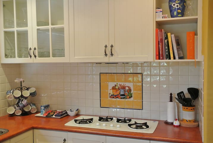 Gas stovetop in the heart of the kitchen.