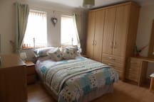 Well appointed bedroom with high quality ,line dried bedding, dressing table,Tv/dvd and hairdryer