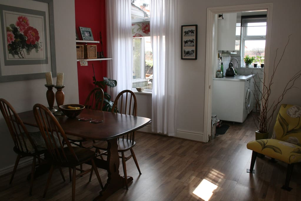 Dining into Kitchen. Double windows for light.