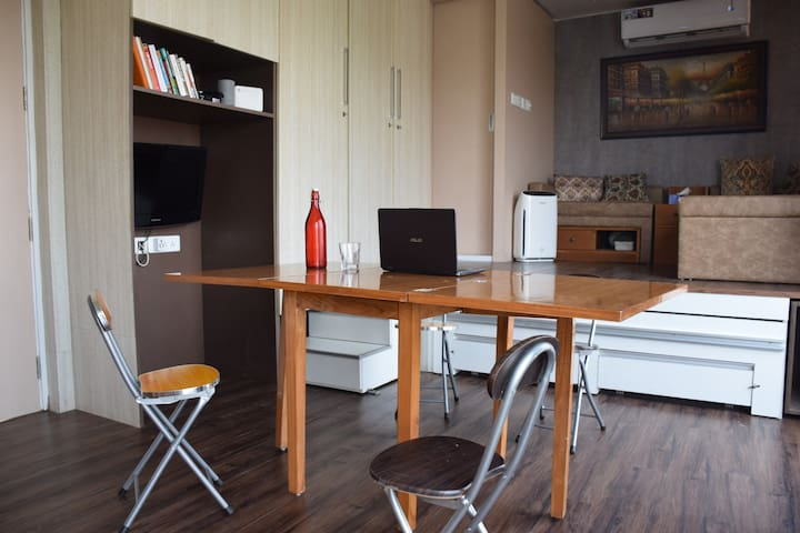 Have people coming over for dinner? The Study table can be opened into a 4 seater dining table. The chairs are foldable with separate storage space for them next to the bed.