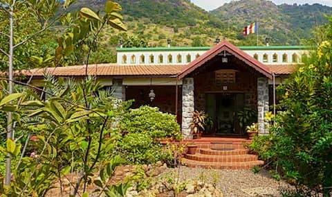 Big bungalow with veranda in a natural setting
