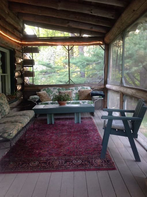 The screened in porch is a welcome place to take meals or just relax!
