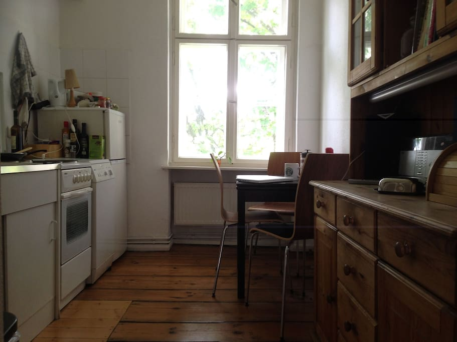 A very nice and cosy kitchen with a beautiful chestnut tree in front of the window