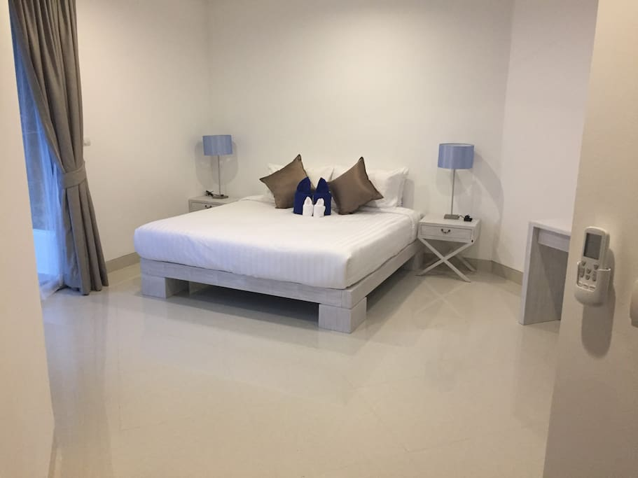 Master Bedroom with King Bed- All bedrooms have builtin cupbaords