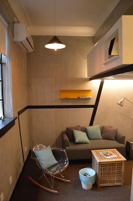 living space with elevated bed above