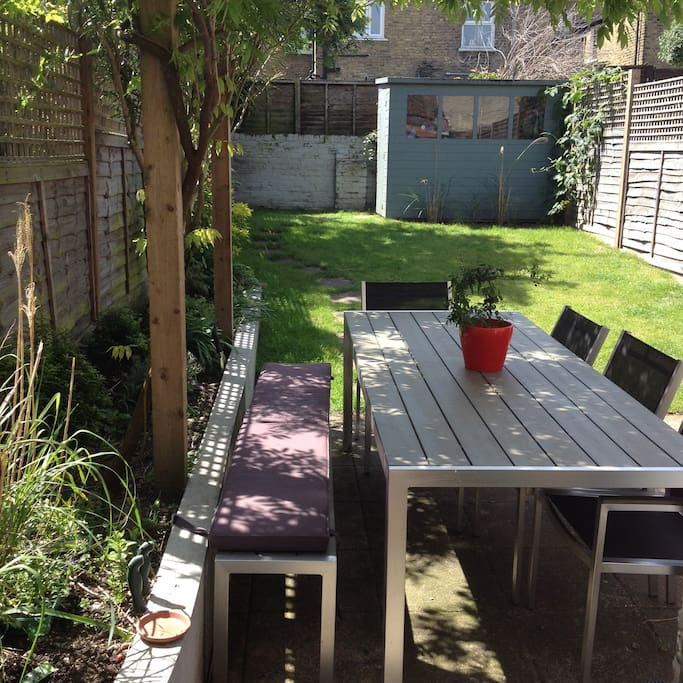 Back garden with space for eating outside/BBQ'ing.