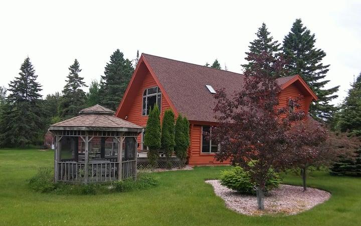 Magnificent log cabin on Lake MI.