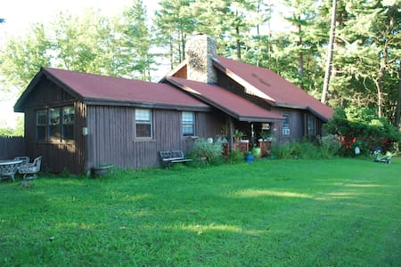 Step back in time in this quaint log home with great views, located just at the NH/ME line, with some modern amenities. You'll enjoy amazing mountain sunsets and can watch for shooting stars out back! WiFi keeps you connected!