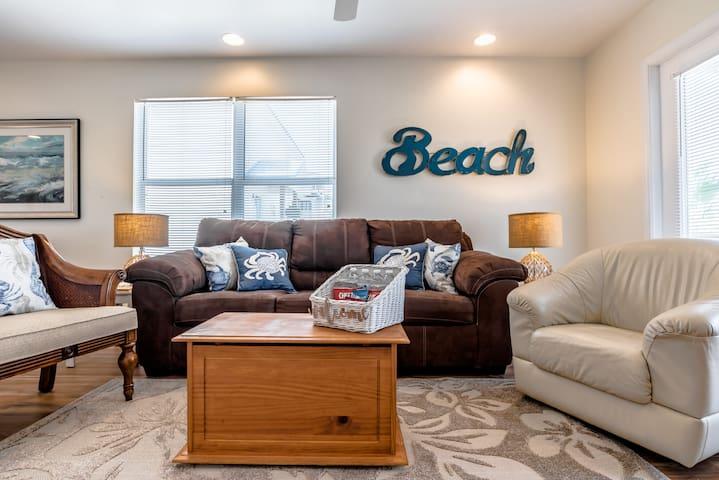 The living room has a queen sleeper sofa and a 42 inch flatscreen TV.