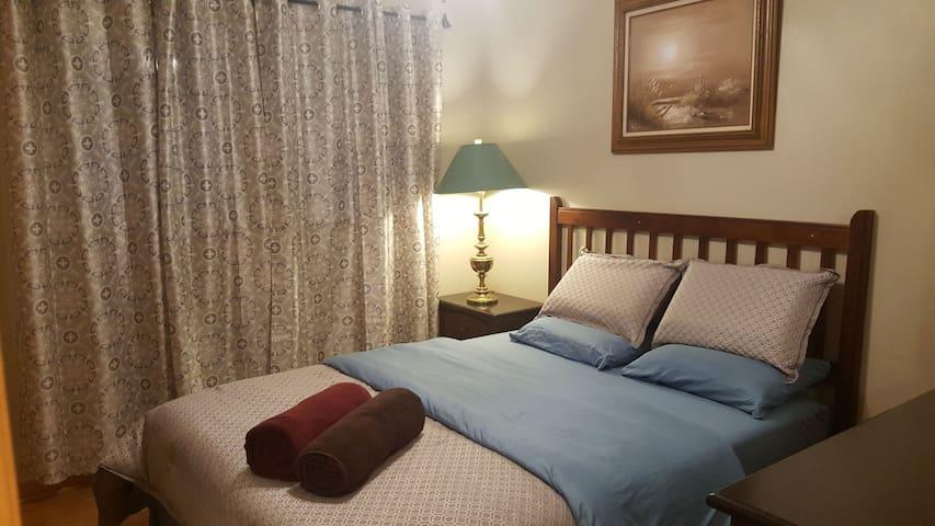 Bedroom #2 comfortable queen bed with memory foam mattress.